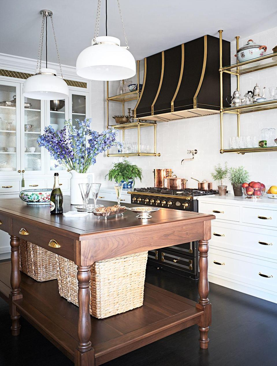 "<p>We imagine some Michelin star-status croissants coming out of a kitchen this beautiful designed by <a href=""https://www.housebeautiful.com/design-inspiration/house-tours/a25647684/summer-thornton-chicago-apartment-tour-transformation/"" rel=""nofollow noopener"" target=""_blank"" data-ylk=""slk:Summer Thornton"" class=""link rapid-noclick-resp"">Summer Thornton</a>. With a gorgeous black and gold hood, gold floating shelves, and a lovely wood kitchen island, it's the perfect blend of French country chic and unpretentious, modern style. </p>"