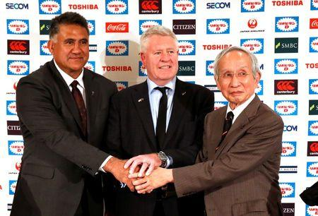 New Zealand Rugby Union CEO Steve Tew (C), Japan's head coach Jamie Joseph (L) and Japan Rugby Football Union President Tadashi Okamura pose for a photograph during their joint news conference in Tokyo, Japan May 17, 2017. REUTERS/Issei Kato