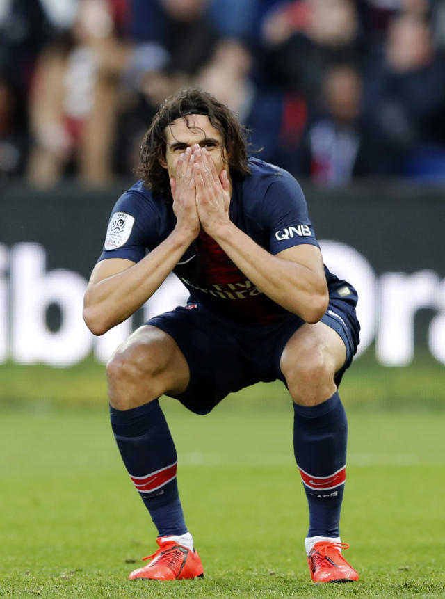 PSG's Edinson Cavani reacts after missing a chance to score during the French League One soccer match between Paris Saint-Germain and Bordeaux at the Parc des Princes stadium in Paris, Saturday, Feb. 9, 2019. (AP Photo/Christophe Ena)