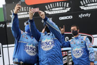 Members of Kevin Harvick's team celebrate after winning the NASCAR Cup Series auto race Sunday, May 17, 2020, in Darlington, S.C. (AP Photo/Brynn Anderson)