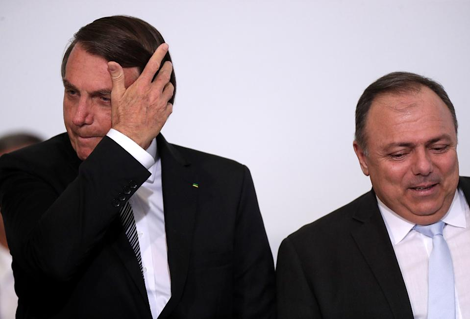 Brazil's President Jair Bolsonaro and Brazil's Health Minister Eduardo Pazuello attend the launch ceremony of a training program for health workers at the Planalto Palace in Brasilia, Brazil, December 8, 2020. REUTERS/Ueslei Marcelino