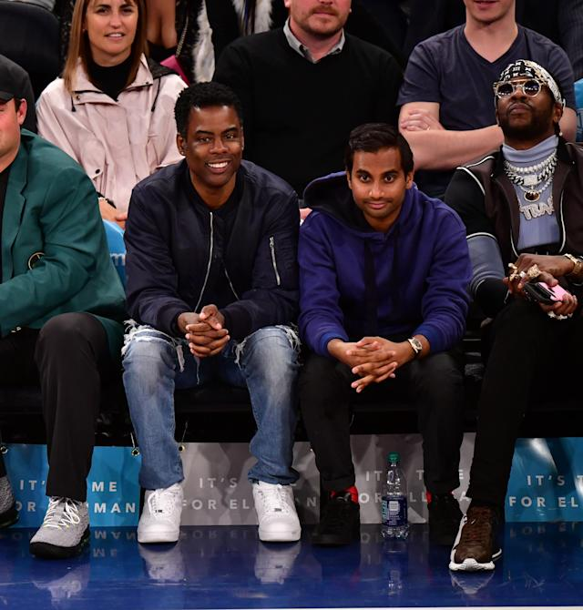 Aziz Ansari — sandwiched by Chris Rock and 2 Chainz — at the New York Knicks vs. Cleveland Cavaliers game at Madison Square Garden on April 9. (Photo: James Devaney/Getty Images)