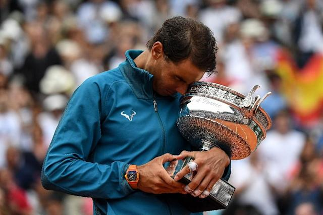Rafael Nadal poses with the Mousquetaires Cup after his 11th title win in Paris in 2018 (AFP Photo/Christophe ARCHAMBAULT)