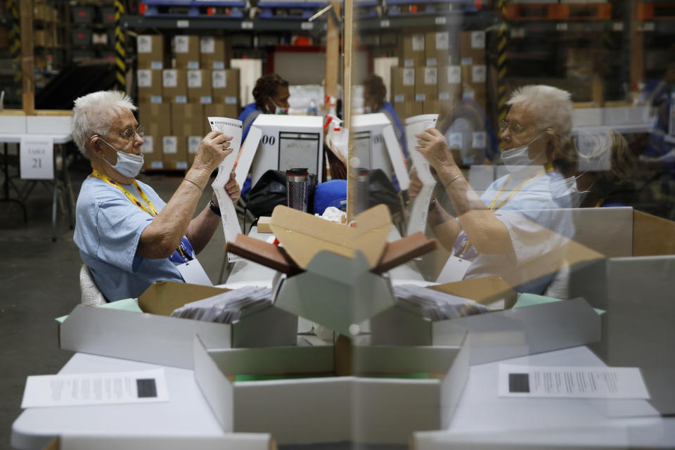 Election workers process mail-in ballots during a nearly all-mail primary election Tuesday, June 9, 2020, in Las Vegas. (AP Photo/John Locher)