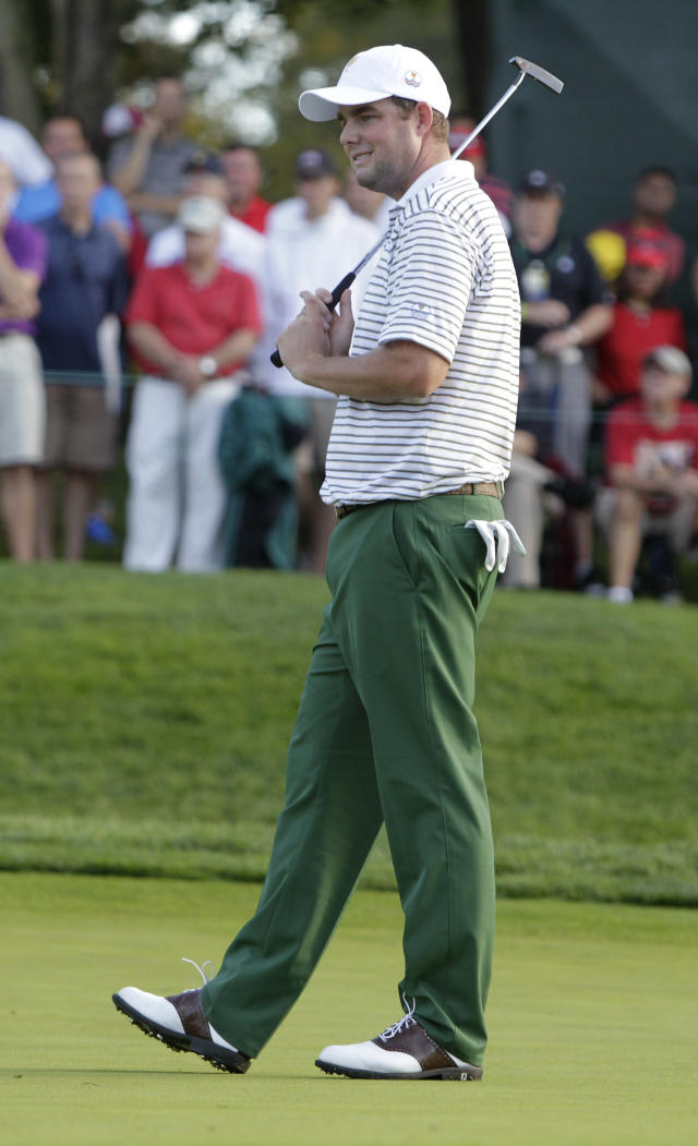 International team player Marc Leishman, of Australia, reacts after missing a putt on the 14th hole during the four-ball match at the Presidents Cup golf tournament at Muirfield Village Golf Club Thursday, Oct. 3, 2013, in Dublin, Ohio. (AP Photo/Jay LaPrete)
