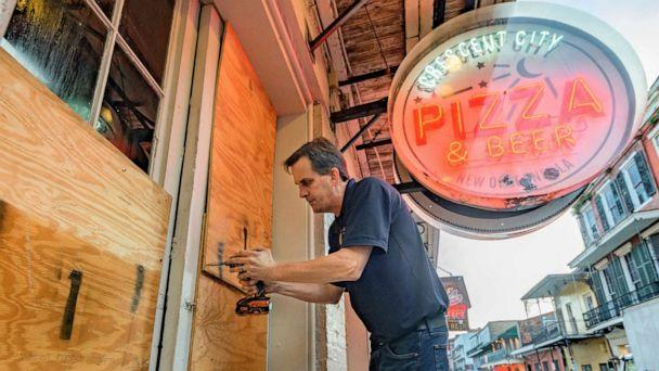 PHOTO: Michael Richard boards up Crescent City Pizza on Bourbon Street in the French Quarter before landfall of Hurricane Ida in New Orleans, Aug. 28, 2021. (Matthew Hinton/AP)
