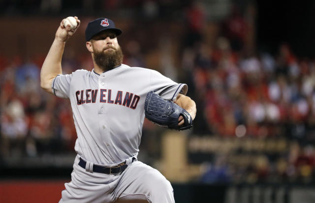FILE - In this June 26, 2018, file photo, Cleveland Indians starting pitcher Corey Kluber throws during the first inning of a baseball game against the St. Louis Cardinals in St. Louis. Two of the top pitchers in the American League square off when the New York Yankees begin a series in Cleveland. Kluber starts for the Indians, while the AL leader in wins, Luis Severino takes the mound for New York in a matchup of 2018 All-Stars. (AP Photo/Jeff Roberson, File)