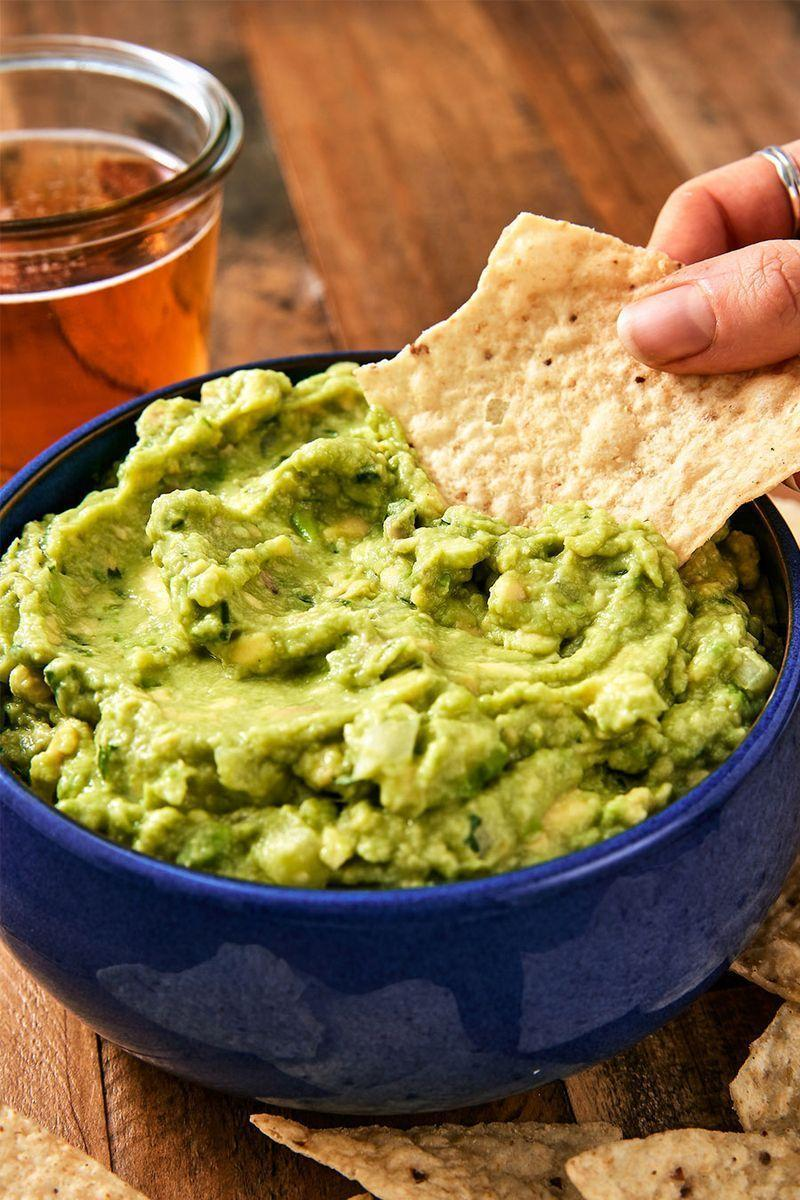 "<p>Everyone has opinions about guac. Some, like us, like it simple. We prefer to let the flavour of our avo's shine. Others like to go crazy on the mix-ins: spices, tomatoes, garlic, etc. If that's your thing, this guacamole is the perfect jumping off point. Add whatever you like!</p><p>Get the <a href=""https://www.delish.com/uk/cooking/recipes/a29947768/best-ever-guacamole-recipe/"" rel=""nofollow noopener"" target=""_blank"" data-ylk=""slk:Guacamole"" class=""link rapid-noclick-resp"">Guacamole</a> recipe.</p>"