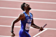 FILE - Noah Lyles of the United States reacts after winning the men's 4x100 meter relay final during the World Athletics Championships in Doha, Qatar, in this Saturday, Oct. 5, 2019, file photo. The U.S. Olympic track trials begin Friday night, June 18, 2021, at remodeled Hayward Field. Some of the biggest events over the first week figure to be the men's 100 meters where Noah Lyles -- one of the faces of the Tokyo Games -- kicks off his bid on a potential 100-200 double. (AP Photo/Martin Meissner, File)