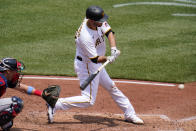 Pittsburgh Pirates' Jacob Stallings singles off Cleveland Indians relief pitcher Phil Maton, driving in a run, during the sixth inning of a baseball game in Pittsburgh, Sunday, June 20, 2021. (AP Photo/Gene J. Puskar)