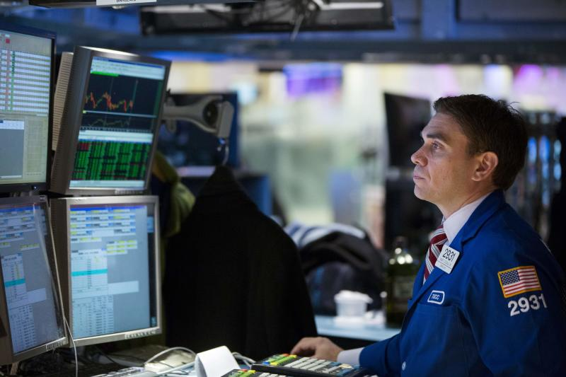 A trader works on the floor of the New York Stock Exchange shortly after the market opening
