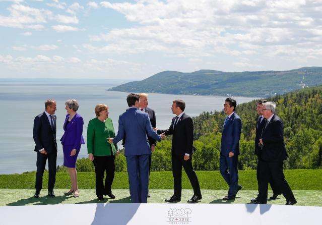 <p>European Council President Donald Tusk, Britain's Prime Minister Theresa May, Germany's Chancellor Angela Merkel, President Donald Trump, Canada's Prime Minister Justin Trudeau, France's President Emmanuel Macron, Japan's Prime Minister Shinzo Abe, Italy's Prime Minister Giuseppe Conte and European Commission President Jean-Claude Juncker pose for a family photo at the G7 Summit in the Charlevoix city of La Malbaie, Quebec, Canada, June 8, 2018. (Photo: Yves Herman/Reuters) </p>