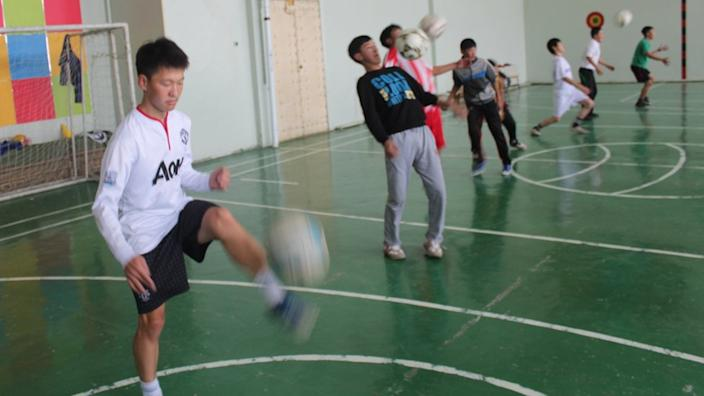 Ochiroo (in white) - who is known as Wazza, after Wayne Rooney - during a full session at the school gym
