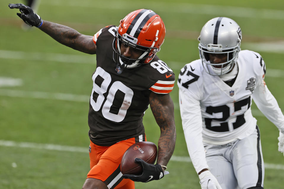 Cleveland Browns wide receiver Jarvis Landry (80) tip toes down the sideline after a catch as Las Vegas Raiders cornerback Trayvon Mullen (27) defends during the second half of an NFL football game, Sunday, Nov. 1, 2020, in Cleveland. (AP Photo/Ron Schwane)