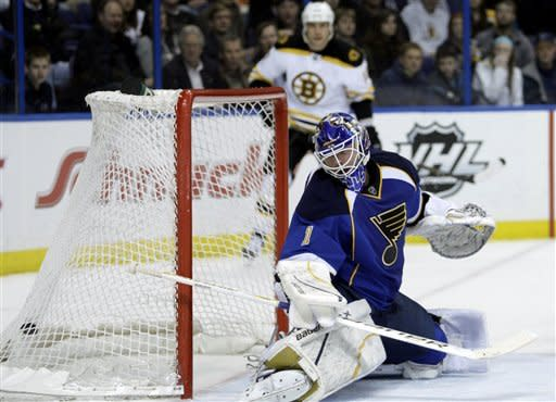 St. Louis Blues goalie Brian Elliott (1) watches a shot by Boston Bruins' Chris Kelly fly into the net during the first period of an NHL hockey game, Wednesday, Feb. 22, 2012, in St. Louis. (AP Photo/Tom Gannam)