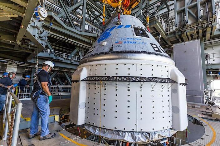 Boeing's CST-100 Starliner capsule is mounted atop a United Launch Alliance Atlas 5 rocket at the Cape Canaveral Space Force Station, setting the stage for launch next week on an unpiloted test flight. / Credit: United Launch Alliance
