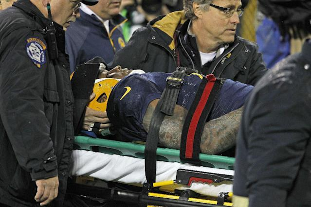 Green Bay Packers tight end Jermichael Finley is taken off the field after being injured on a play against the Cleveland Browns during an NFL football game Sunday, Oct. 20, 2013, in Green Bay, Wis. (AP Photo/Matt Ludtke)