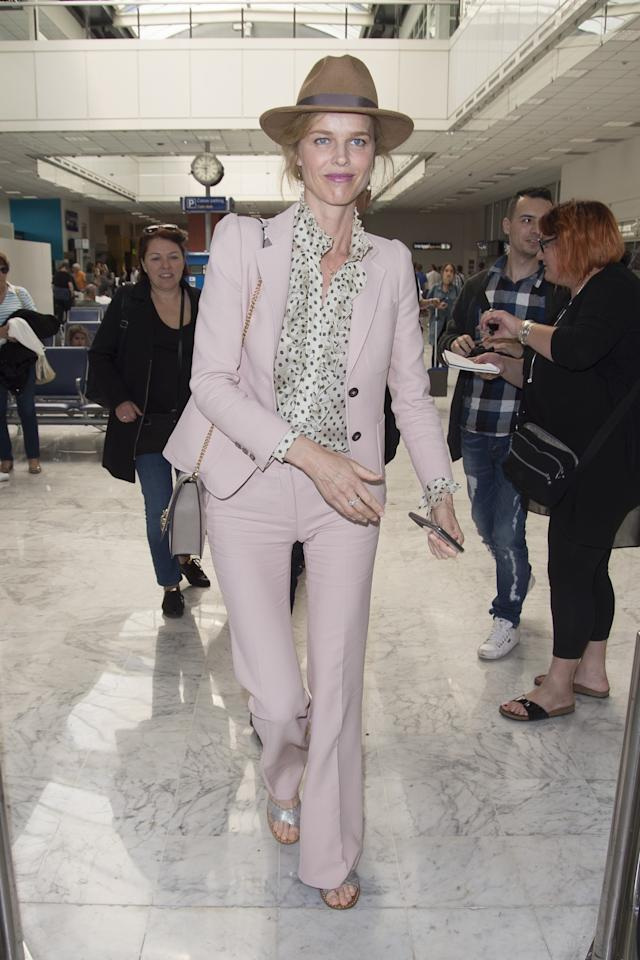 <p>Eva Herzigova arrives at Nice Airport ahead of the 2017 Cannes Film Festival. She was wearing a pastel pink suit with a spotted blouse and a brown fedora hat. (Photo: AKM-GSI) </p>