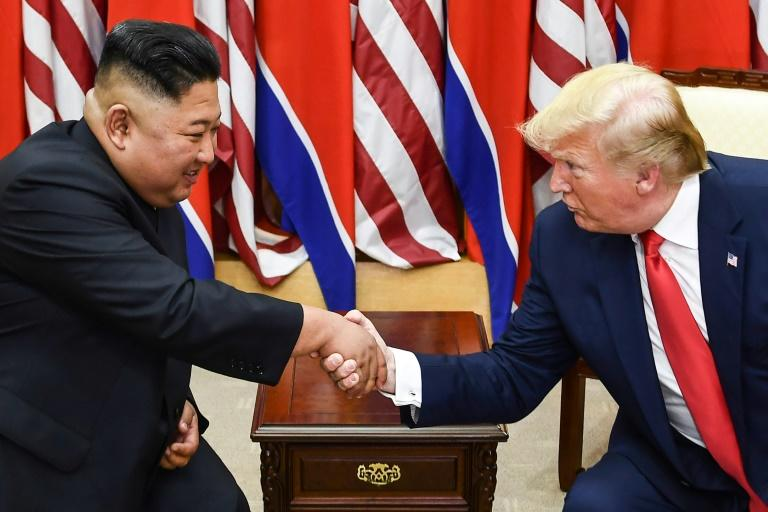 North Korea's leader Kim Jong Un (L) and US President Donald Trump shake hands during their meeting in the Demilitarized Zone dividing North and South Korea on June 30, 2019