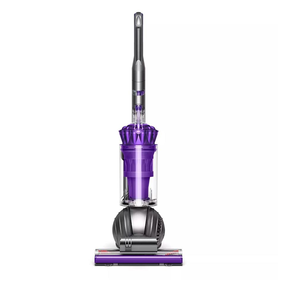"""Engineered for a home with pets, this upright vacuum uses ball technology to navigate tricky floor plans, has a counter-rotating brush head to tackle hair from carpets and upholstery without leaving a hard-to-remove wrap-around behind, and has all the tools you need for the same versatility as the cordless options. Say goodbye to dust, animal hair, and ground-in dirt. $500, Target. <a href=""""https://www.target.com/p/dyson-ball-animal-2-upright-vacuum-iron-purple/-/A-52190951"""" rel=""""nofollow noopener"""" target=""""_blank"""" data-ylk=""""slk:Get it now!"""" class=""""link rapid-noclick-resp"""">Get it now!</a>"""