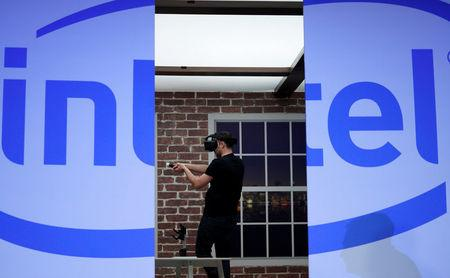 FILE PHOTO - Gameplayers demonstrate vitual reality headsets during the Intel press conference at CES in Las Vegas