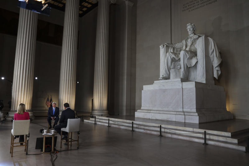 WASHINGTON, DC - MAY 03: President Donald Trump (C) speaks with news anchors Martha MacCallum (L) and Bret Baier (R) during a Virtual Town Hall inside of the Lincoln Memorial on May 3, 2020 in Washington, DC. (Photo by Oliver Contreras-Pool/Getty Images)