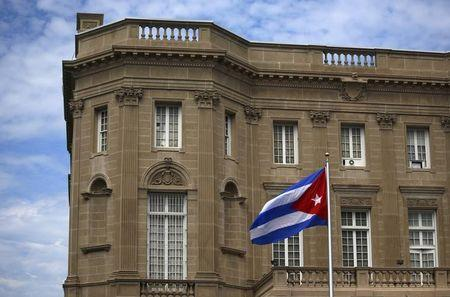 FILE PHOTO - Cuban national flag is seen raised over their new embassy in Washington