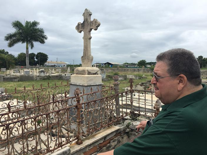 My dad, Ed Delfin, looks out at Cementerio la Reina in Cienfuegos. Family members are buried here. The hauntingly beautiful cemetery is weathered by time, floods and more.
