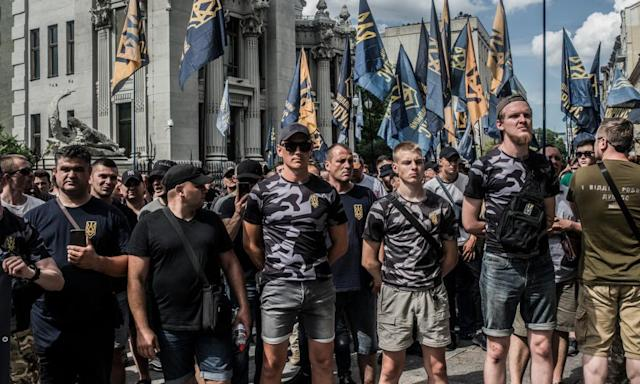 "<span class=""element-image__caption"">Soldiers, veterans and supporters of Azov Battalion hold a protest at the Ukrainian parliament in 2019. Some members of the group are involved in far-right MMA events.</span> <span class=""element-image__credit"">Photograph: Martyn Aim/Getty Images</span>"