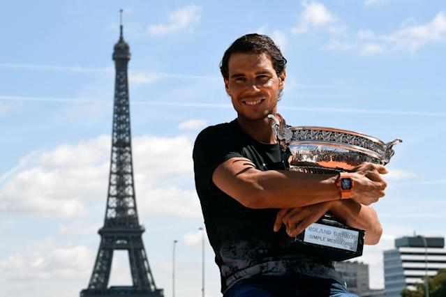 Rafael Nadal claimed a record 10th French Open title last year, while Jelena Ostapenko took the women's crown (AFP Photo/CHRISTOPHE SIMON)
