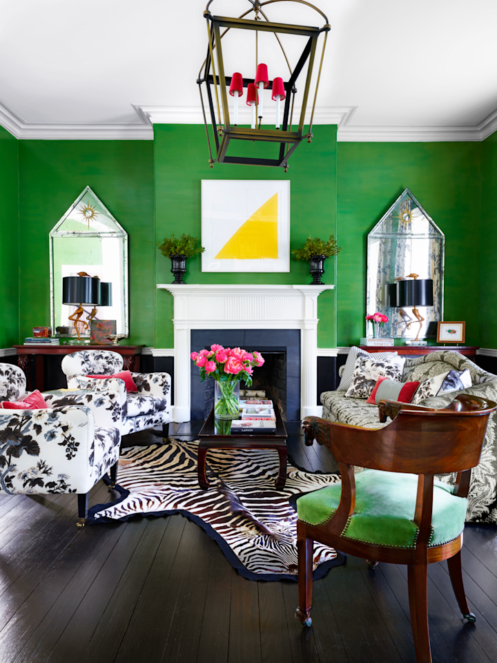 "<p>Black-and-white floral fabrics (<a href=""https://www.fschumacher.com/"">Schumacher</a>) and a 1940s lacquer cocktail table ground the verdant, lacquered walls in this Washington, D.C. home. Designer <a href=""https://branca.com/"">Alessandra Branca</a> added pops of hot pink to further establish a exuberant spirit in the historic home. </p>"