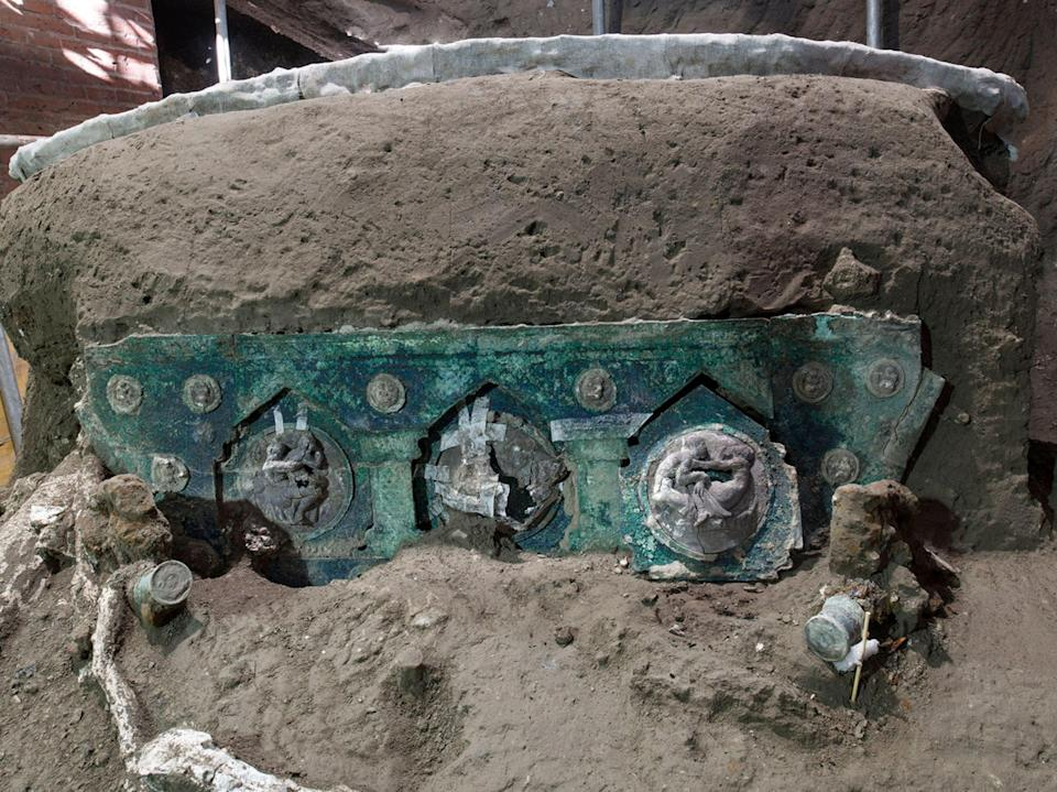 <p>The ceremonial chariot was uncovered in a porch at a Roman villa outside the walls of Pompeii</p> (POMPEI ARCHAEOLOGICAL PARK/AFP)