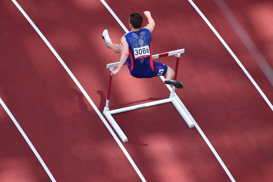 Norway's Carsten Warhome competes in the men's 400m hurdles final during the Tokyo 2020 Olympics on August 3, 2021 at the Olympic Stadium in Tokyo.  Photo by ANTONIN THUILLIER / AFP via Getty Images)