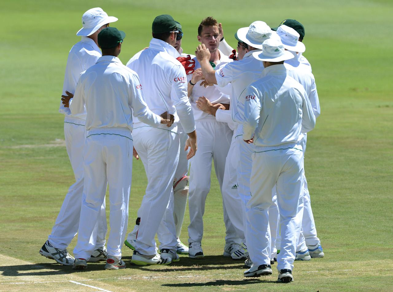 JOHANNESBURG, SOUTH AFRICA - FEBRUARY 02:  Dale Steyn of South Africa is congratulated by teammates for taking the wicket of Muhammad Hafeez of Pakistan for 6 runs during day 2 of the 1st Test match between South Africa and Pakistan at Bidvest Wanderers Stadium on February 02, 2013 in Johannesburg, South Africa.  (Photo by Duif du Toit/Gallo Images/Getty Images)