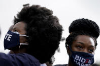 Women listen during a drive-in rally for Democratic presidential candidate former Vice President Joe Biden at Cellairis Amphitheatre in Atlanta, Tuesday, Oct. 27, 2020. (AP Photo/Andrew Harnik)