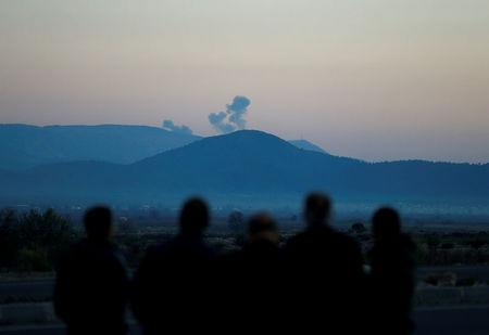 FILE PHOTO: Smoke rises from the Syria's Afrin region, as it is pictured from near the Turkish town of Hassa, on the Turkish-Syrian border in Hatay province