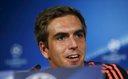 Bayern Munich's Lahm speaks during a news conference ahead of their Champions League match against Olympiacos in Athens