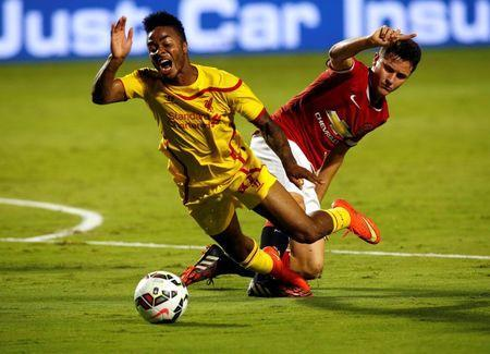 Aug 4, 2014; Miami Gardens, FL, USA; Liverpool midfielder Raheem Sterling (31) is defended by Manchester United player Ander Herrera in the first half at Sun Life Stadium. Mandatory Credit: Robert Mayer-USA TODAY Sports