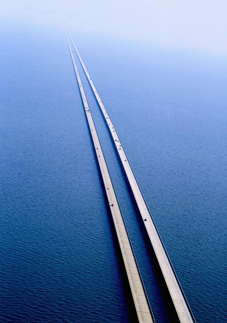 """<p> The Lake Pontchartrain Causeway bridge in New Orleans, Louisiana is the <a href=""""https://www.atlasobscura.com/places/lake-pontchartrain-causeway"""" rel=""""nofollow noopener"""" target=""""_blank"""" data-ylk=""""slk:longest continuous bridge"""" class=""""link rapid-noclick-resp"""">longest continuous bridge</a> passing over water. It's nearly 24 miles long (and for eight of those miles, you can't even see any land at all).  </p><p><strong>RELATED:</strong> <a href=""""https://www.goodhousekeeping.com/life/travel/g2425/beautiful-photos-america/"""" rel=""""nofollow noopener"""" target=""""_blank"""" data-ylk=""""slk:51 Photos That Prove America Truly Is Beautiful"""" class=""""link rapid-noclick-resp"""">51 Photos That Prove America Truly Is Beautiful</a></p>"""
