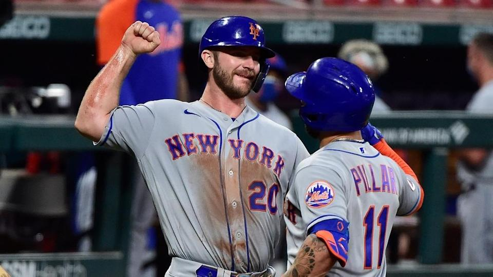 Pete Alonso Kevin Pillar at home plate on road May 2021