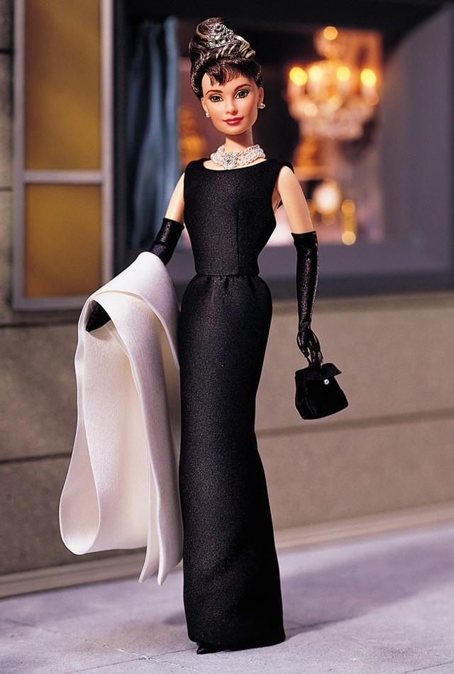 "<div class=""caption-credit""> Photo by: barbiecollector.com</div><b>Audrey Hepburn in ""Breakfast at Tiffany's"" doll, released in 1998 for $79.99</b> <br> This doll flew off shelves as it mimicked one of the biggest on-screen style icons in her tiara, triple-strand pearl necklace, and mini LBD. She even comes with a coffee cup just like the one she sipped from in the opening scene."