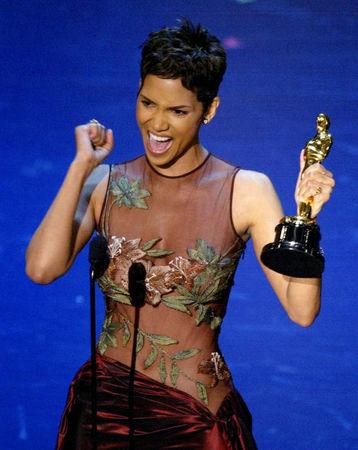"""FILE PHOTO:    Actress Halle Berry reacts to winning the Oscar for Best Actress during  the 74th annual Academy Awards in Hollywood March 24, 2002. Berry won the Academy Award for her role in the film """"Monster's Ball"""".  REUTERS/Gary Hershorn/File Photo"""