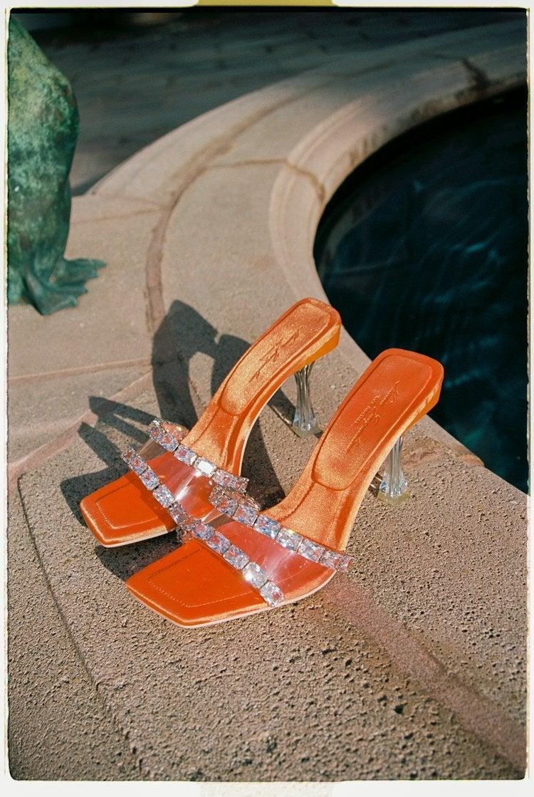 """<br><br><strong>Nana Jacqueline</strong> Bellah Sandals, $, available at <a href=""""https://go.skimresources.com/?id=30283X879131&url=https%3A%2F%2Fnanajacqueline.com%2Fcollections%2Fescape-to-the-chateau%2Fproducts%2Fbellah-sandals-orange"""" rel=""""nofollow noopener"""" target=""""_blank"""" data-ylk=""""slk:Nana Jacqueline"""" class=""""link rapid-noclick-resp"""">Nana Jacqueline</a>"""