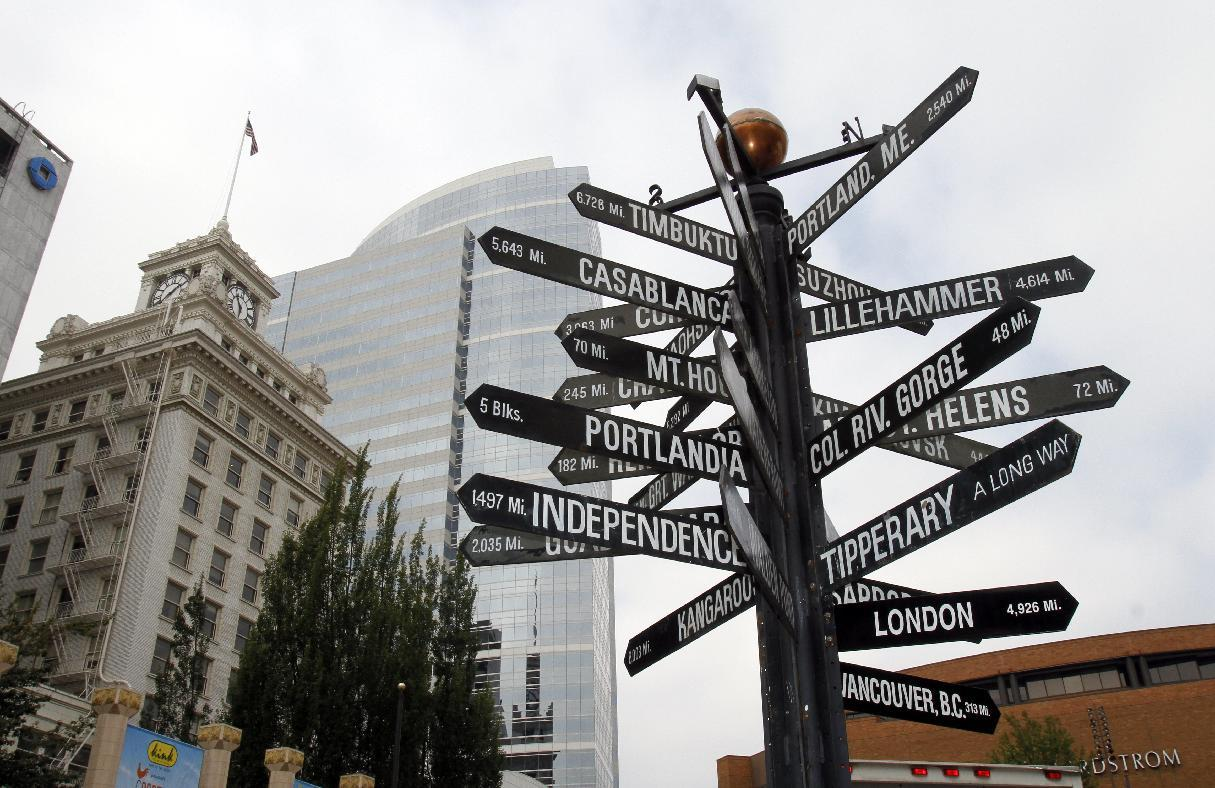 A sign with multiple worldwide destinations is shown in downtown Portland, Ore., Wednesday, Sept. 19, 2012. Researchers at Portland State University found that the Portland atmosphere and culture is a magnet for the young and college educated, even though a disproportionate share of them are working in part-time jobs or positions that don't require a college degree. (AP Photo/Don Ryan)