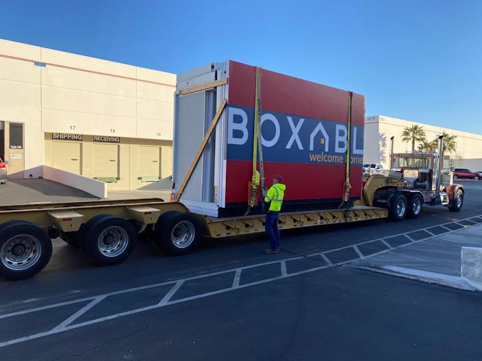 the Boxabl logo on a unit being moved