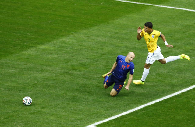 Arjen Robben of the Netherlands falls after having his shirt pulled by Brazil's Thiago Silva in the penalty box during their 2014 World Cup third-place playoff at the Brasilia national stadium in Brasilia July 12, 2014. REUTERS/Ruben Sprich (BRAZIL - Tags: SOCCER SPORT WORLD CUP)