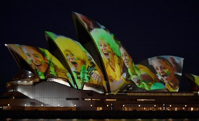 Sydney Opera House was lit up in celebration of Australia and New Zealand's joint bid (AFP Photo/PETER PARKS)