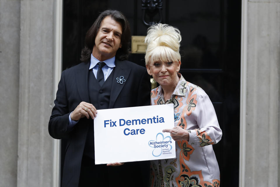 British actress Barbara Windsor (R) and her husband Scott Mitchell pose outside 10 Downing Street as she delivers a petition calling for urgent action on dementia care on September 2, 2019. (Photo by Tolga AKMEN / AFP) (Photo credit should read TOLGA AKMEN/AFP via Getty Images)