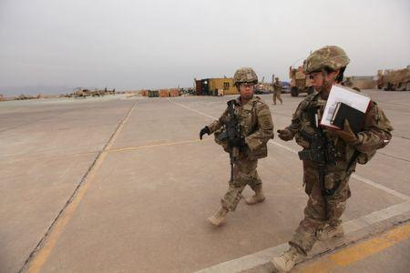 FILE PHOTO - U.S army soldiers walk at the Qayyarah West Airfield