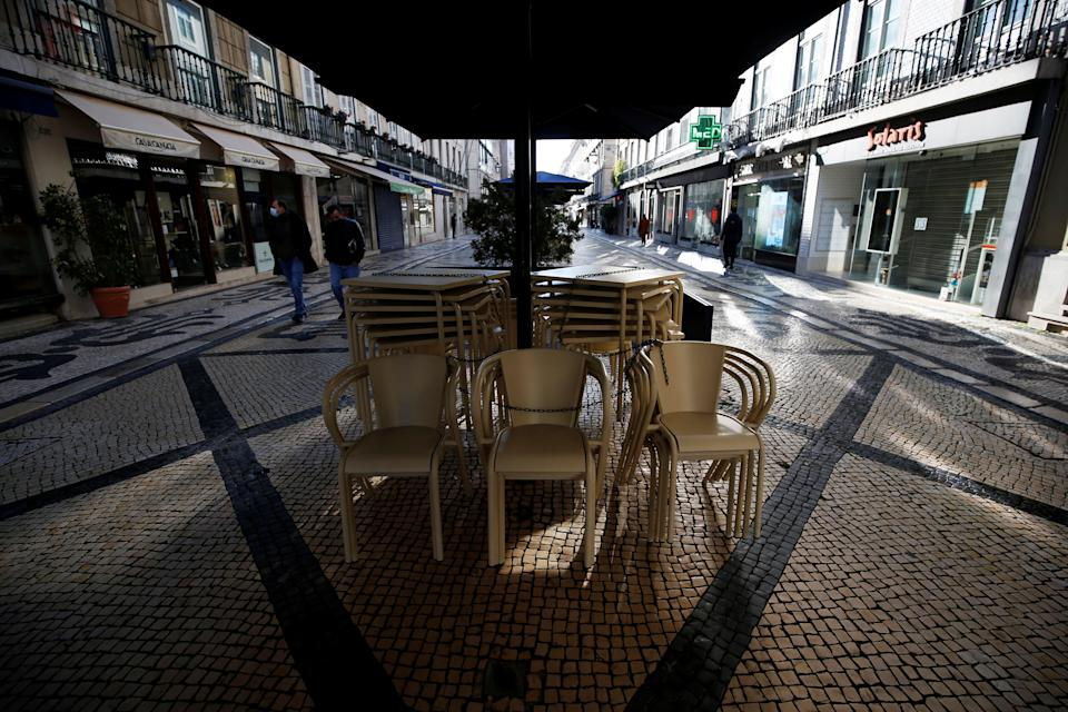 Chairs and tables from a restaurant are seen stacked on the first day of the second national lockdown due to the coronavirus disease (COVID-19) pandemic in Lisbon, Portugal, January 15, 2021. REUTERS/Pedro Nunes